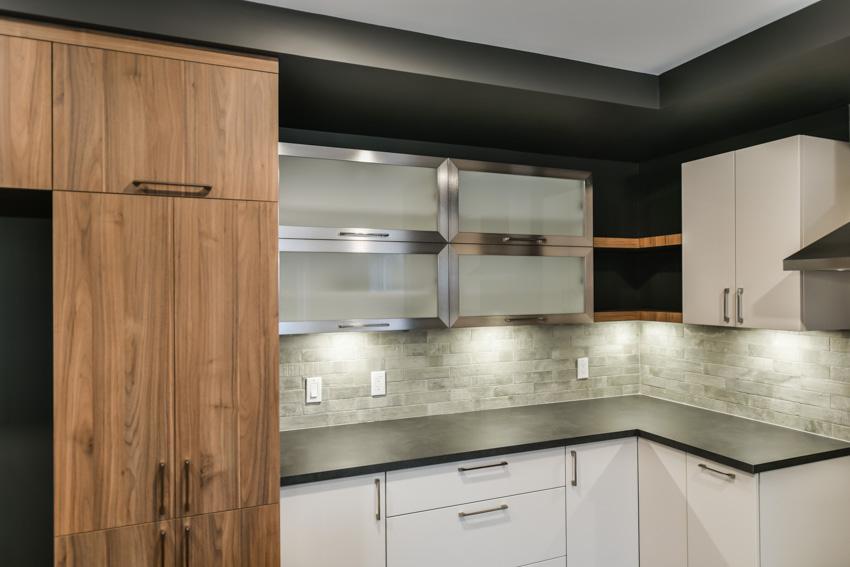 Wood cabinets kitchen countertop under cabinet lighting backsplash