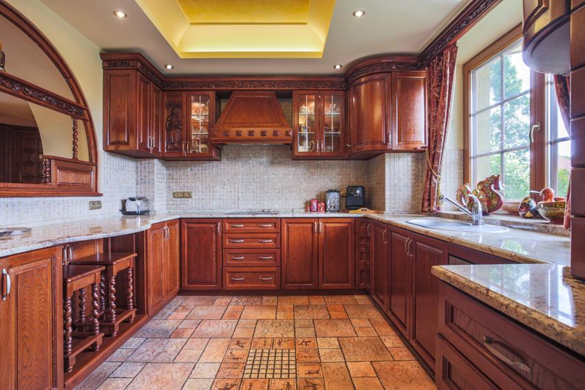 Wood tuscan kitchen tile flooring hood white walls window