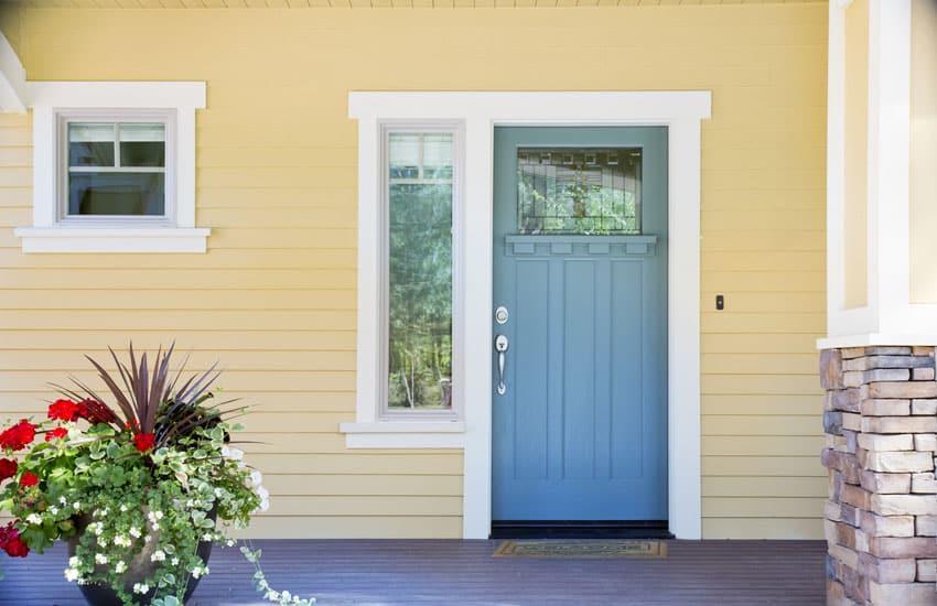 Yellow house blue door