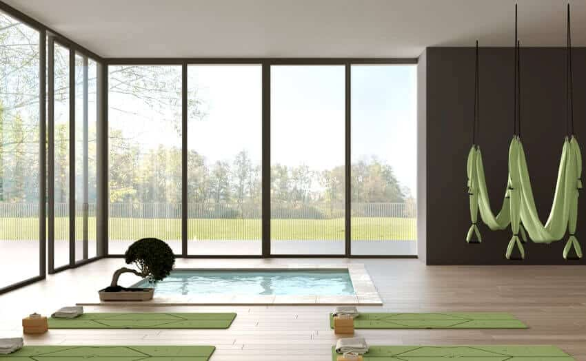 A yoga studio interior design minimal open space with mats hammocks and accessories spa pool and bonsai
