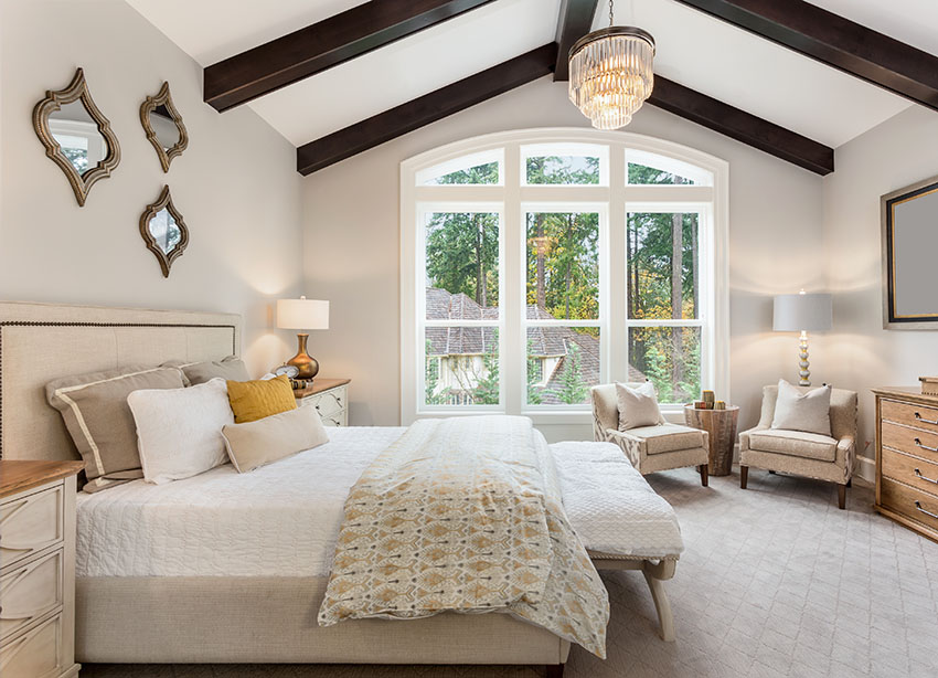 Bedroom with cathedral ceiling chandelier double hung windows