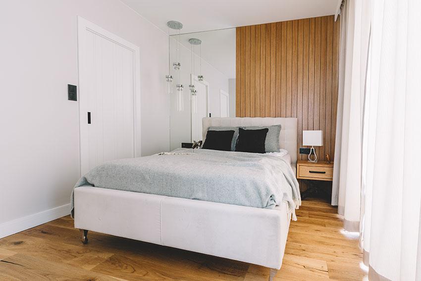 Bedroom with wooden floor white paint