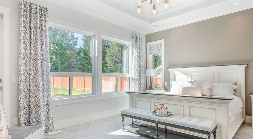 Modern farmhouse bedroom with gray paint and custom window