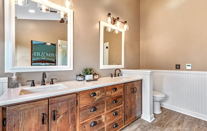 Beautiful bathroom with wooden cabinets and beige wall paint color