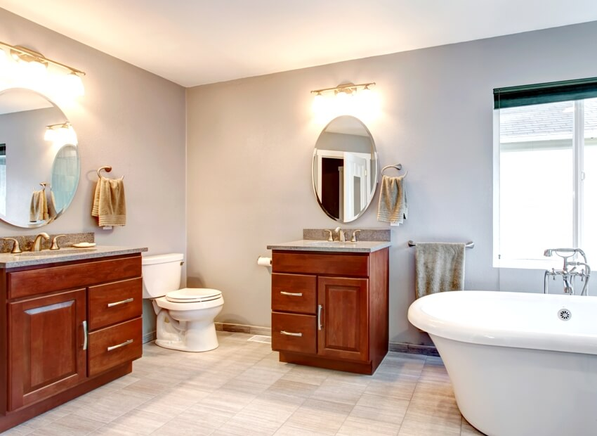 Beautiful grey new luxury modern bathroom interior with two separate sinks with dark cabinets