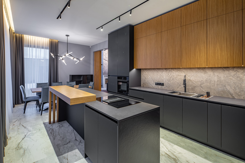 Black and wood kitchen with cabinets appliances curtain chandelier