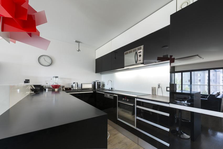 Black cabinets appliances white ceiling modern kitchen