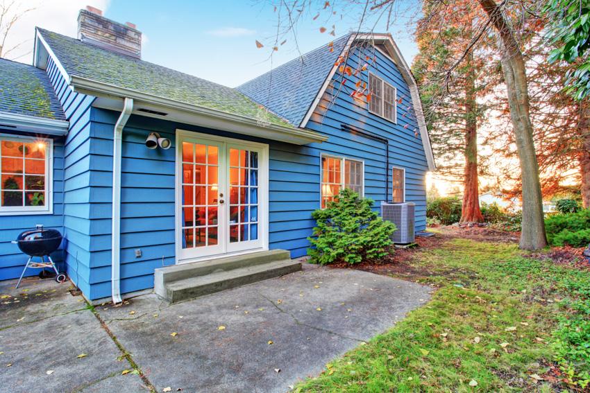 Blue clapboard house glass doors