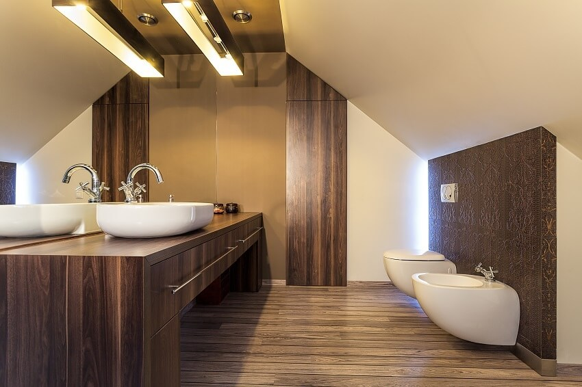 Bright bathroom on the attic with laminate wall panels