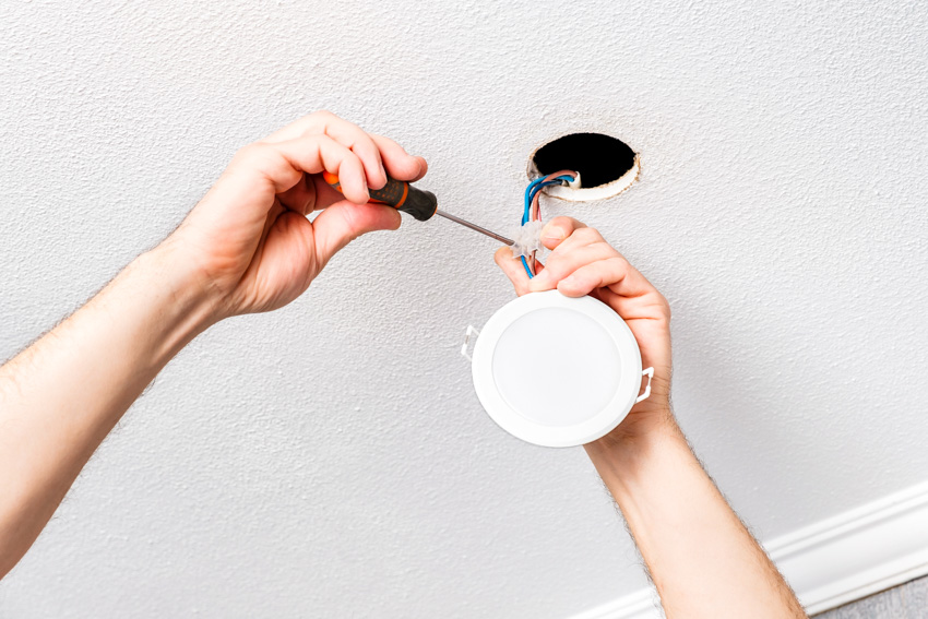 Canless recessed light being installed
