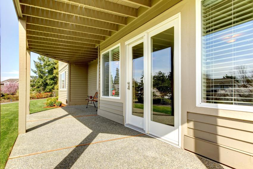Clapboard siding glass door front porch windows shutters