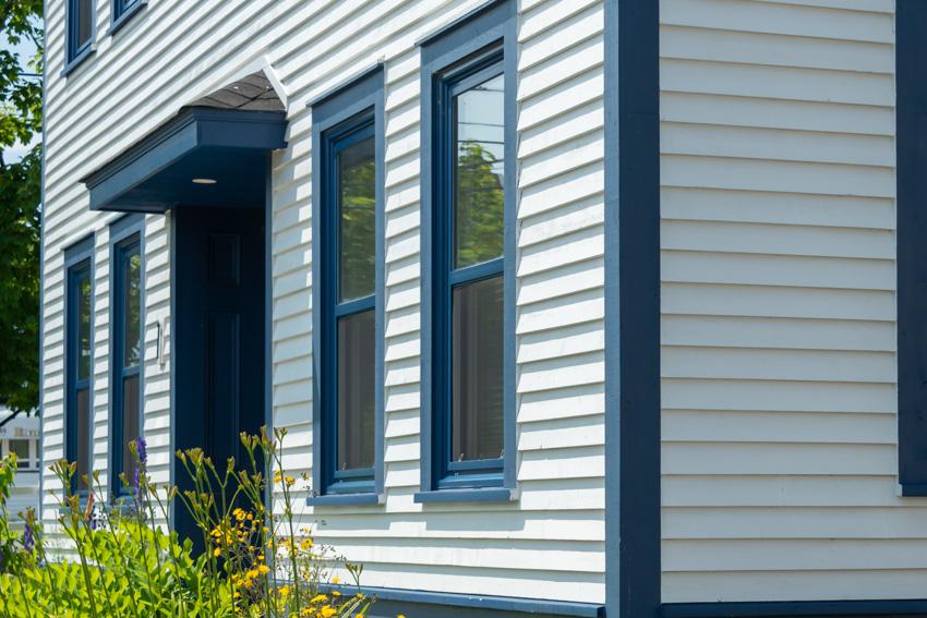Clapboard siding green blue trim color glass window