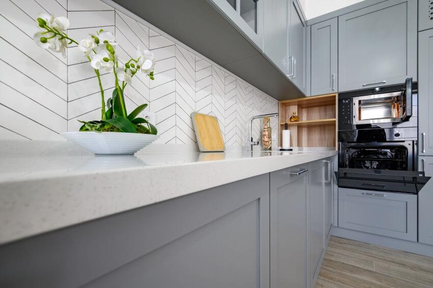 A closeup to corner of luxury grey and white modern kitchen interior