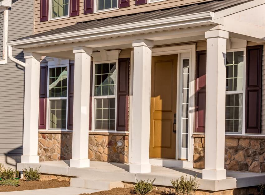 Colonial white porch post columns using wood looking low maintenance vinyl column wraps