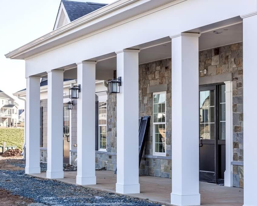 Colonial white porch post using pvc column wraps