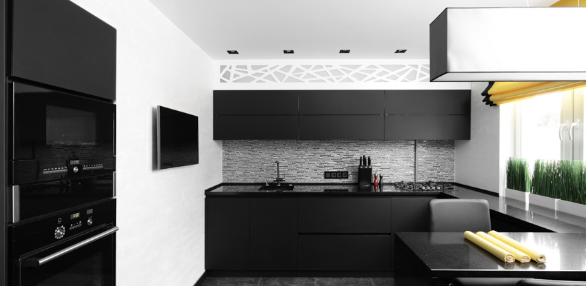 Contemporary kitchen black cabinet appliances hood recessed lighting