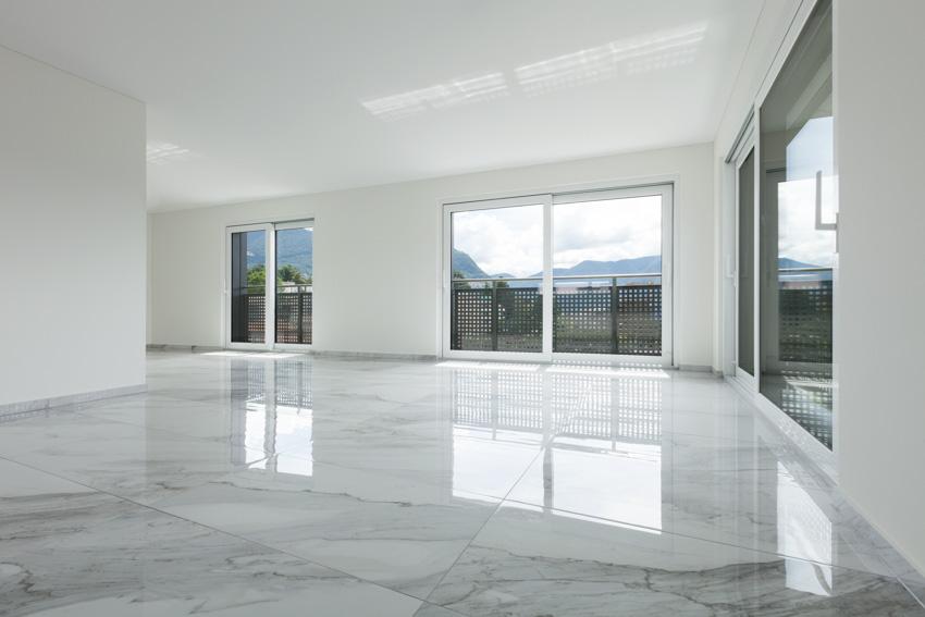 Empty room glass windows marble like porcelain floors