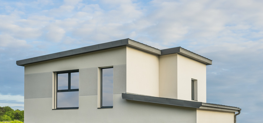 Flat pitched roof white house exterior