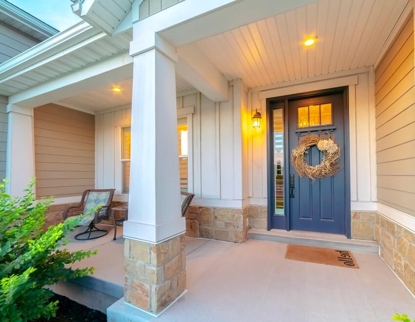 Front and sidelight of home with front porch and wood siding exetrior wall