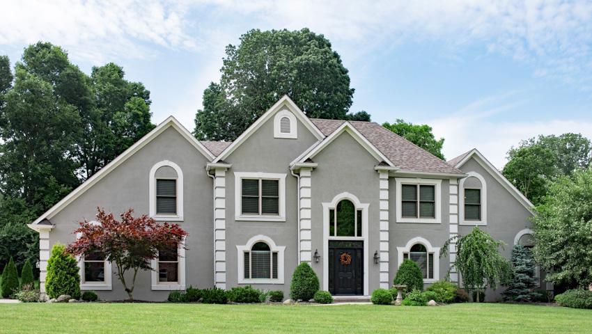 Grey house exterior made of stucco