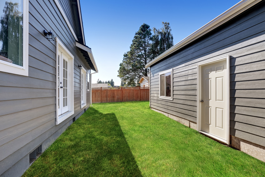 Houses with clapboard sidings front door