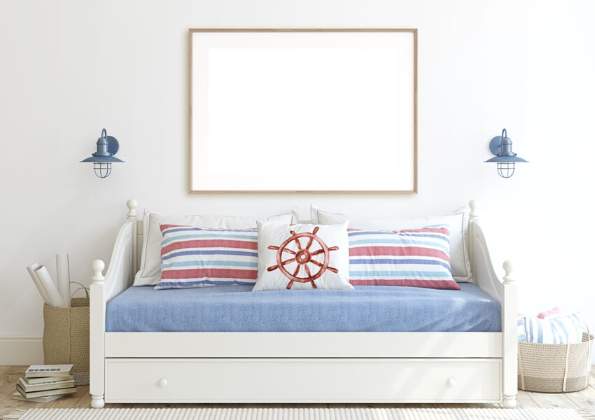 Kid's room in coastal style with daybed near white wall
