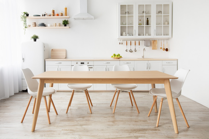 Kitchen and dining space combined wood chairs table cabinets countertop sink