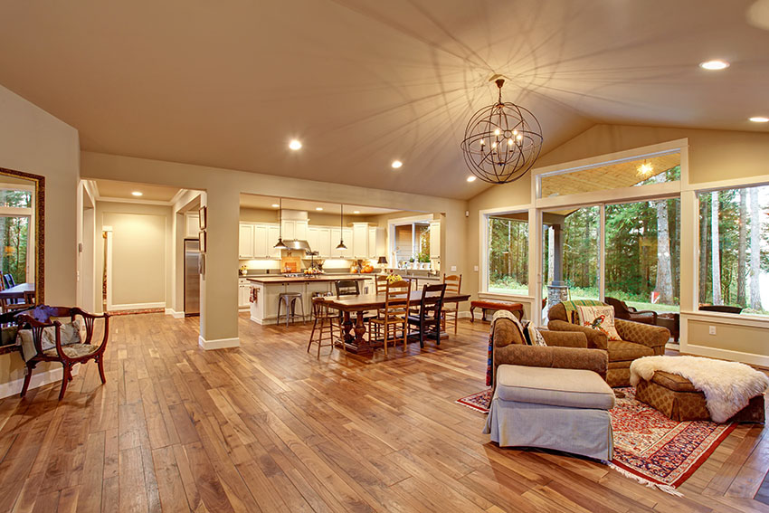 Large living room with asian walnut flooring vaulted ceiling