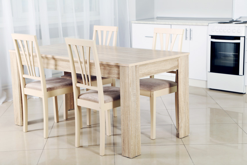 Light wooden table chairs oven kitchen and dining room combined