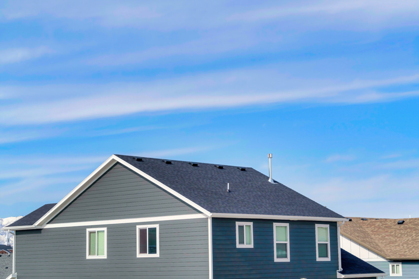 Low pitched roof gray house exterior