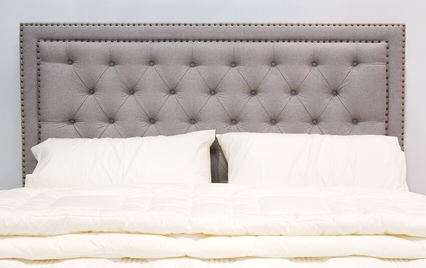 Luxury modern style bedroom and cozy bed with tufted headboard