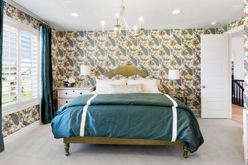Master bedroom patterned walls green bedsheet window curtain recessed lighting