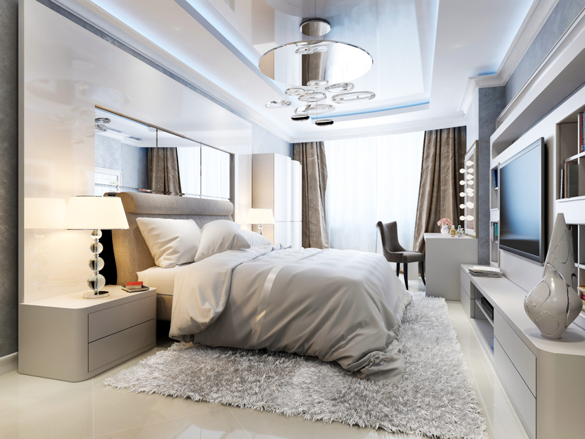 Mirror panels above bed and on the ceiling large window television bedroom