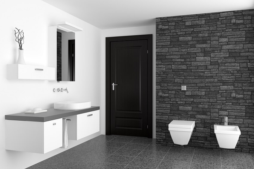 Modern bathroom with black faux stone cladding wall and white toilet