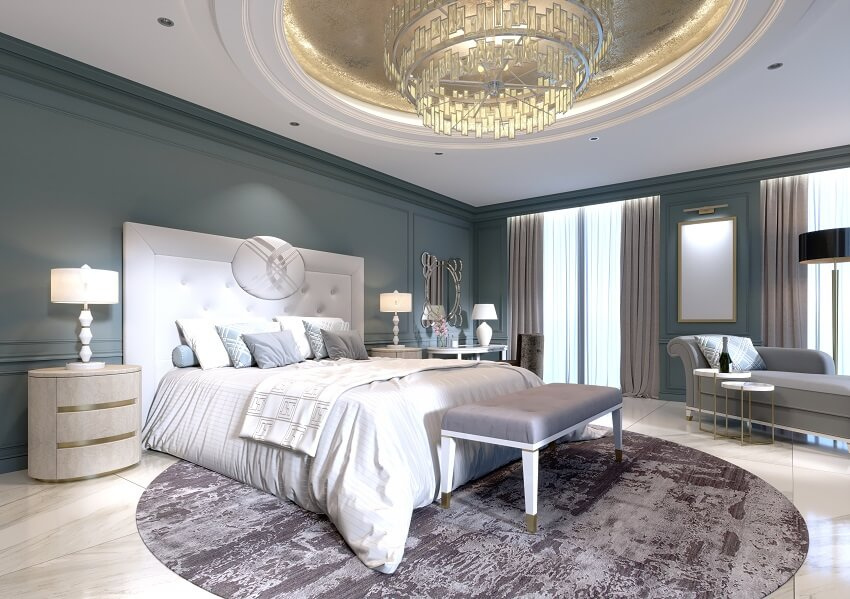Modern design of master bedroom with a large white bed and a stool with a dressing table nearby