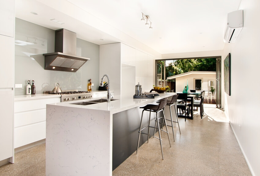 Modern gourmet kitchen interior with furnishings and appliances