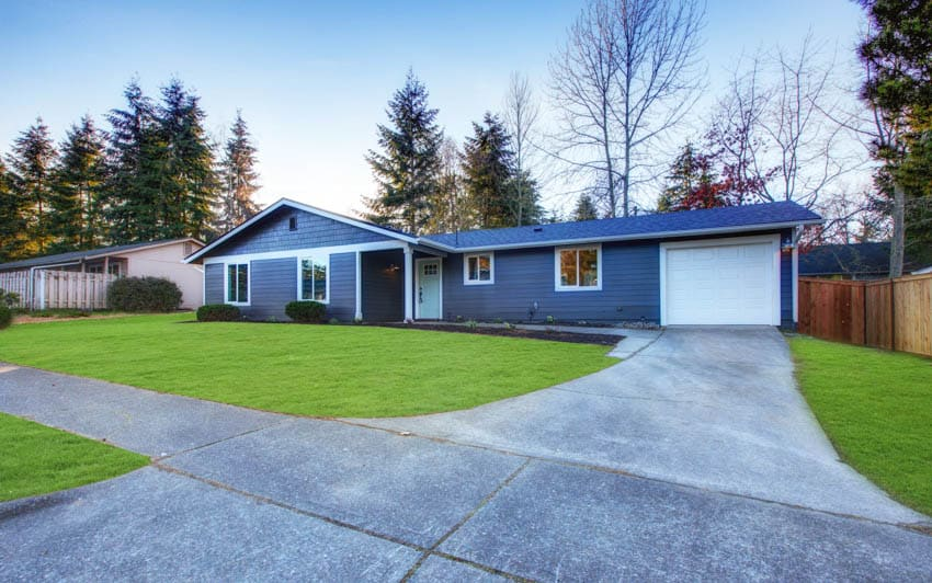 One story house with low pitched roof concrete driveway