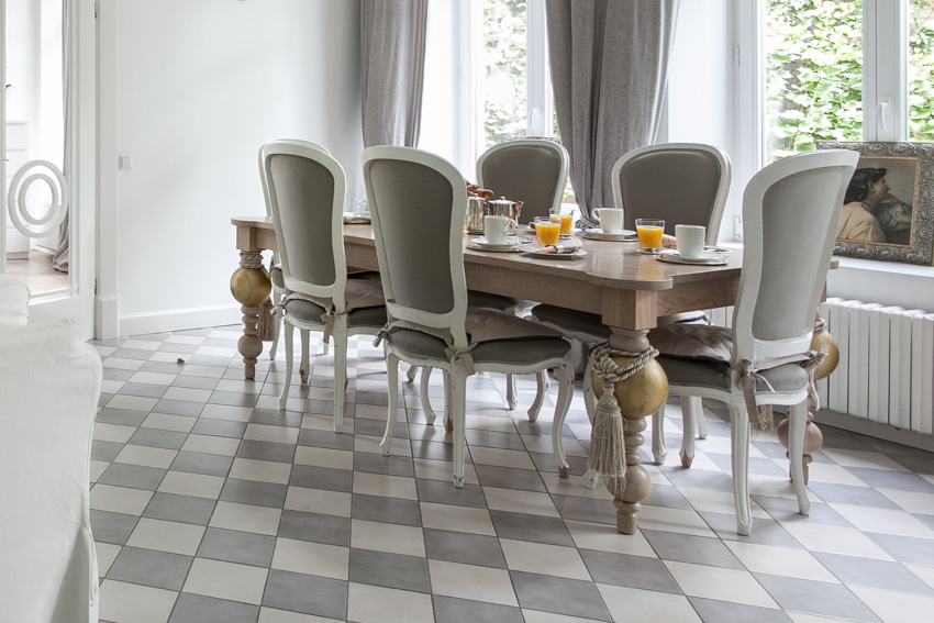 Patterned flooring dining table chairs large windows curtain