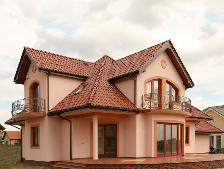 Red house exterior double pitched roof