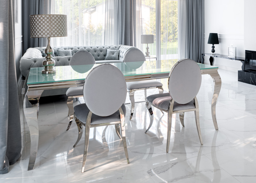 Silver dining table chairs windows curtains dining table