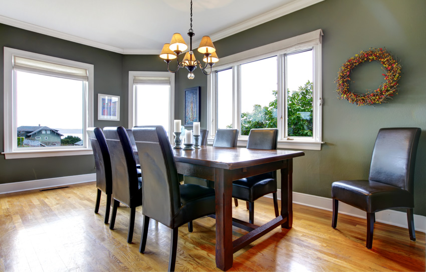 Solid wood table wooden flooring chandelier dining area windows