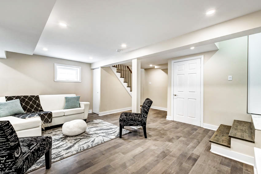 Spacious basement with wooden floor sofa chairs and canless recessed lighting ceiling lights