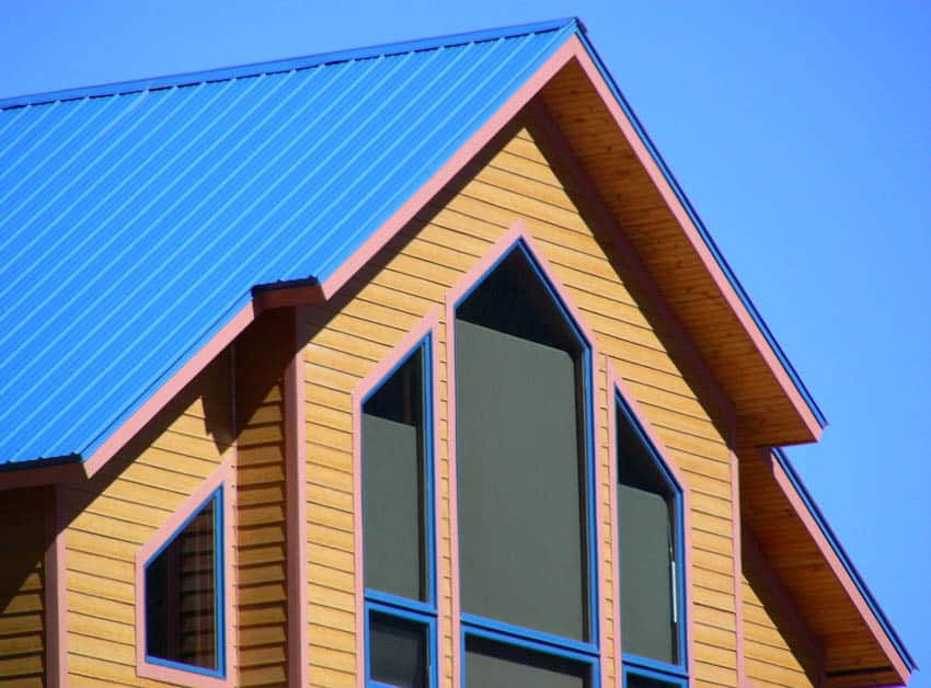 Steep pitched metal blue roof