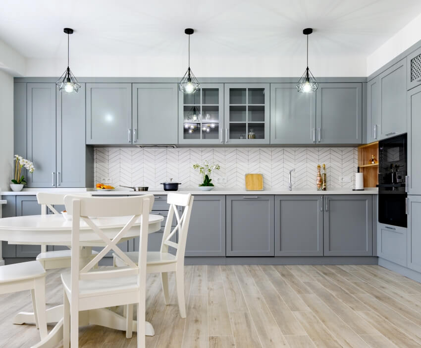 Trendy grey and white modern kitchen with white backsplash