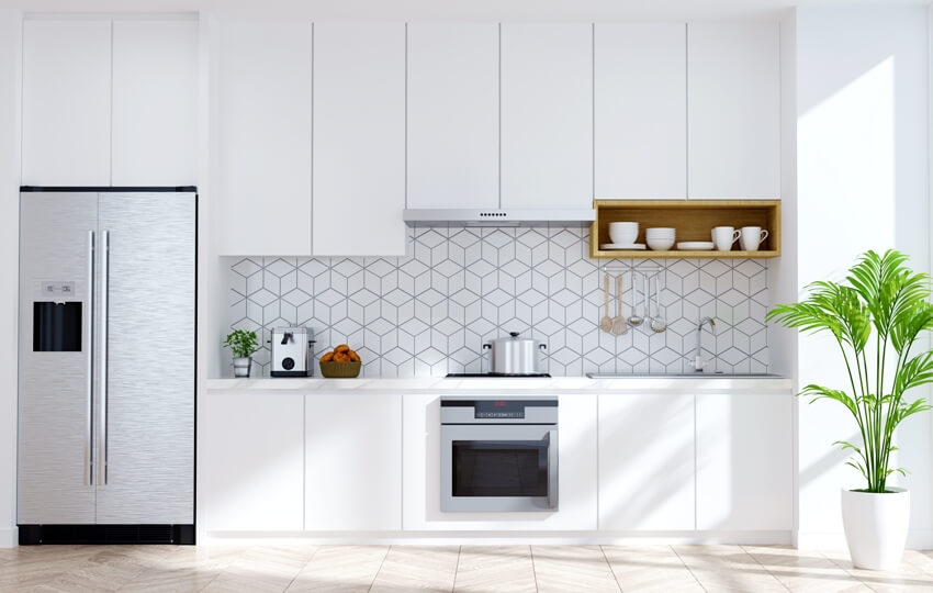 White modern kitchen interior with stainless steel appliances and white with cube design backsplash