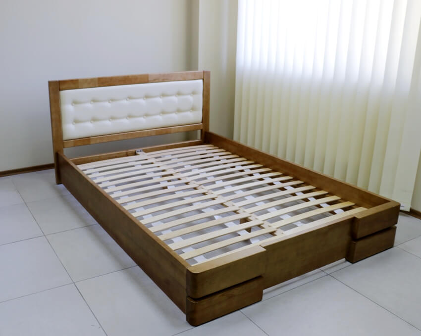Wooden bed frame with cut slats