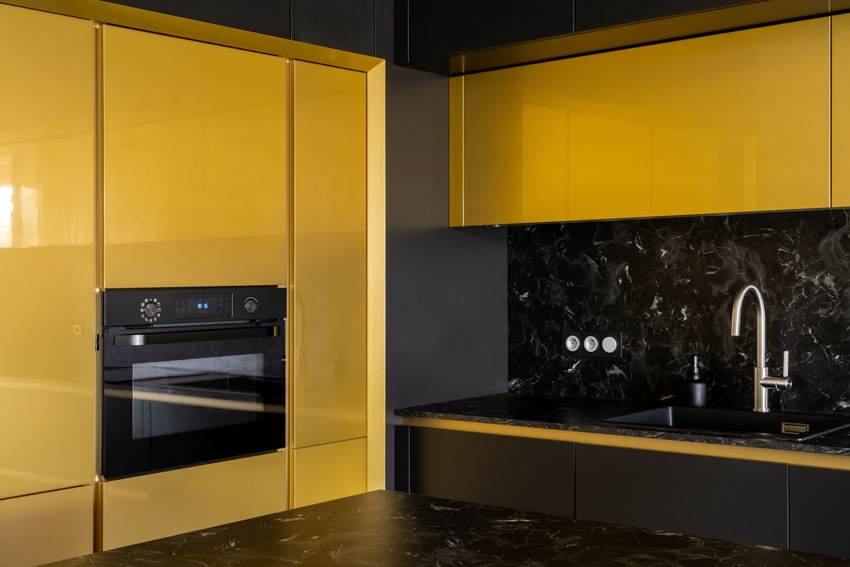 Yellow cabinets black stainless steel oven sink faucet